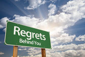 Regrets, Behind You Green Road Sign — Stock Photo