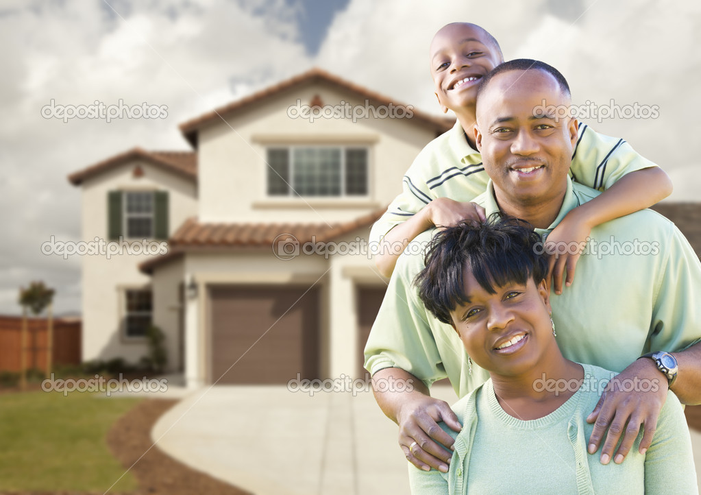 Happy black family in front of house for American family homes