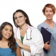 Hispanic Female Doctor with Child Patient and Colleague — Foto de Stock
