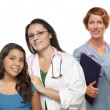 Hispanic Female Doctor with Child Patient and Colleague — ストック写真