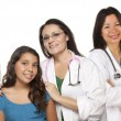 Hispanic Female Doctor with Child Patient and Colleagues — Stock Photo
