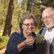 Stock Photo: Attractive Senior Couple Overlooking Potted Plants
