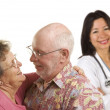 Senior Couple with Medical Doctor or Nurse Behind — Stock fotografie