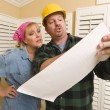 Contractor in Hard Hat Discussing Plans with Woman — Stock Photo