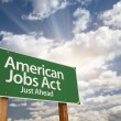 Royalty-Free Stock Photo: American Jobs Act Green Road Sign
