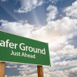 Safer Ground Green Road Sign - Stock Photo