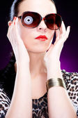 Beautiful elegant young woman with sunglasses — Stock Photo