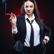Elegant young woman with cigar — Stock Photo #5485960