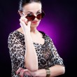 Stock Photo: Elegant young woman in sunglasses