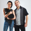 Portrait of man and woman with a small black dog - ストック写真