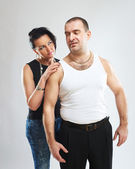Portrait of a gangster in white tank top with his woman — Stockfoto