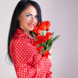 Royalty-Free Stock Photo: Portrait of a woman with red flowers