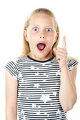 Surprised little girl pointing with finger — Stock Photo
