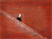 Men Walking down Stairs Brick Wall — Stock Photo