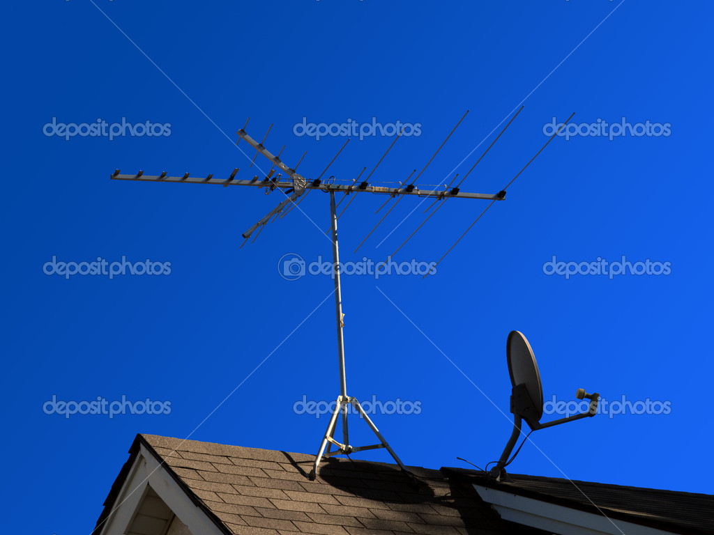 Satellite transmission dish against blue sky  Stock Photo #6203865