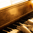Playing Antique Piano - Stock Photo