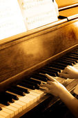 Playing Antique Piano — Stock Photo