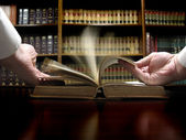 Hand on Law Book — Stock Photo