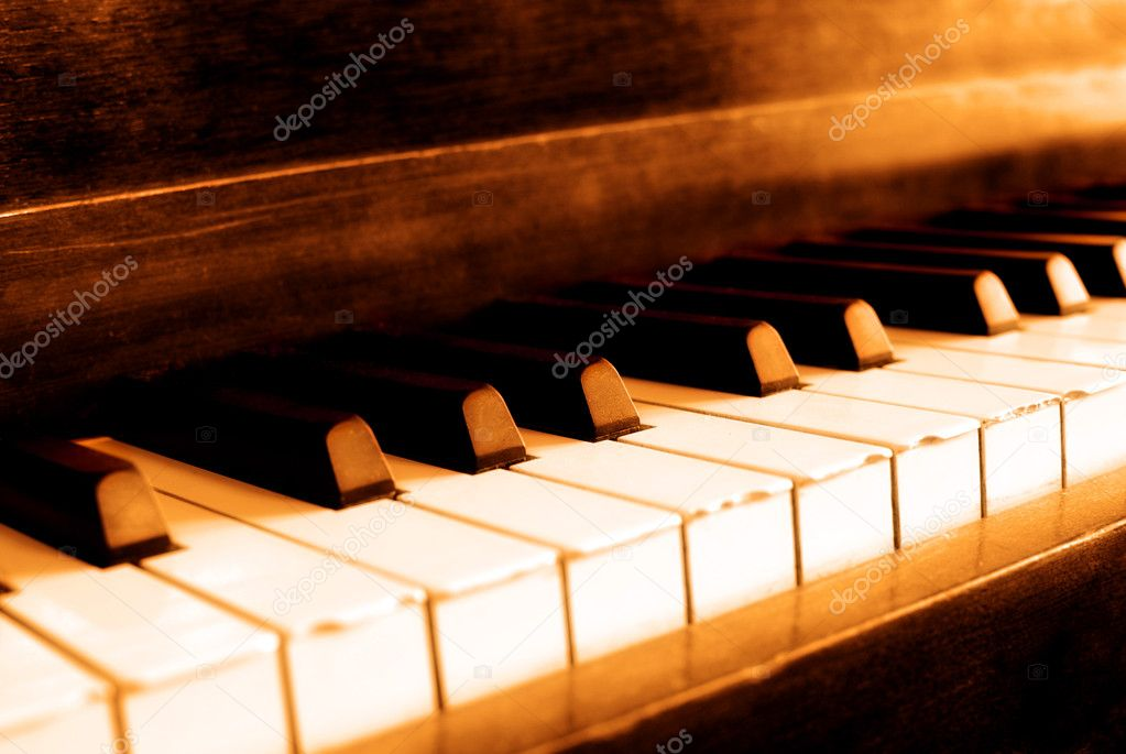Closeup of black and white piano keys and wood grain with sepia tone  Stock Photo #6321894