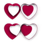 Four valentine heart gift boxes — Stock Photo