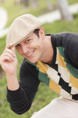 Handsome man tipping his hat — Stock Photo