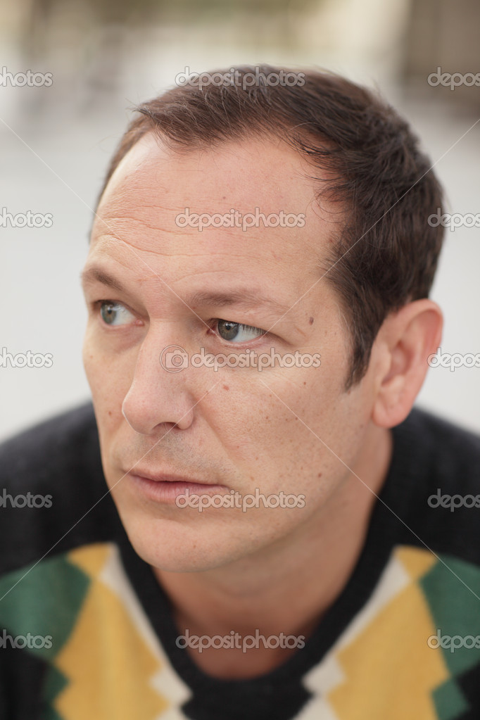 Image of a man glancing away from the camera  Stock Photo #5463239