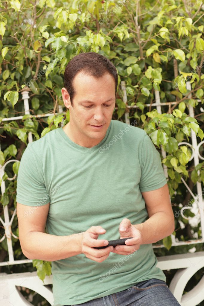 Image of a modern man using his smartphone  Stock Photo #5463350