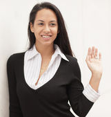 Woman smiling and waving — Stock Photo