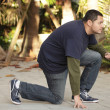 Man in a crouching pose — Stock Photo