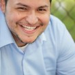 Latino businessman smiling — Stock Photo