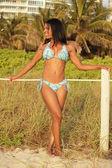 Happy bikini model glancing away — Stock Photo