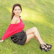 Attractive woman posing on the grass - Stock Photo
