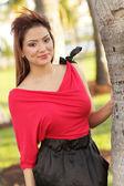 Model posing in the park — Stock Photo