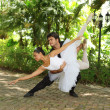 Couple dancing ballet in the park - Stock Photo