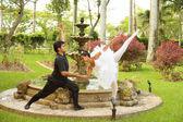 Ballerinas dancing in a garden — Stock Photo