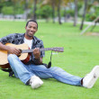 Happy musician in the park - Stock Photo
