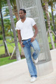 Handsome black man in the park — Stock Photo