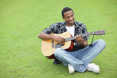 Happy musician in the park — Foto Stock