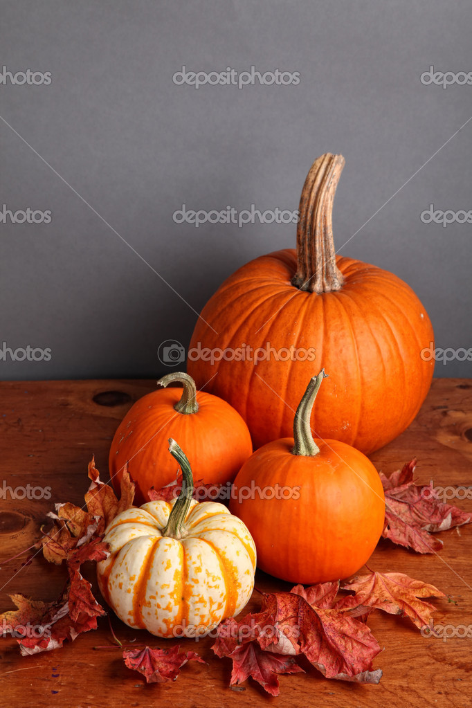 Fall pumpkin and decorative squash with autumn leaves on a wooden table. — Stock Photo #5781819