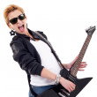 Woman screaming while playing an electric guitar — Stock Photo #5435760