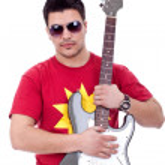 Guitarist embracing his electric guitar — Stock Photo