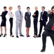 Happy business man with team behind — Stock Photo #5589832