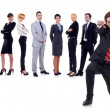 Happy business man with team behind — Stock Photo