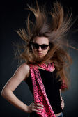 Woman with blown hair wearing sunglasses — Stok fotoğraf