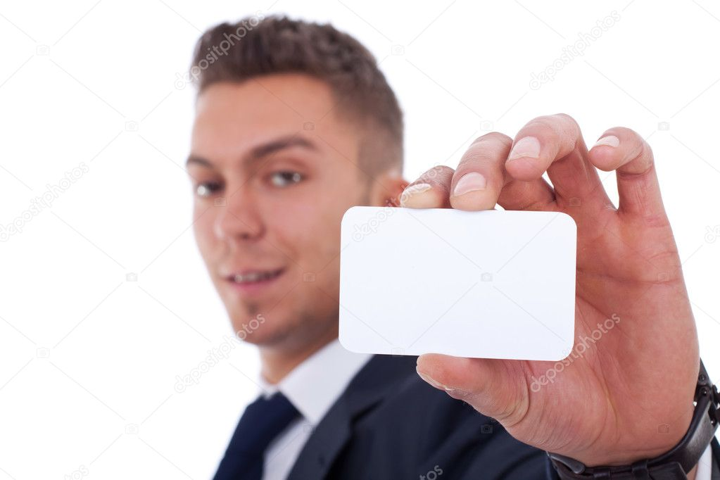 Business man handing a blank business card over white background, focus on hand and card  — Stock Photo #5589482