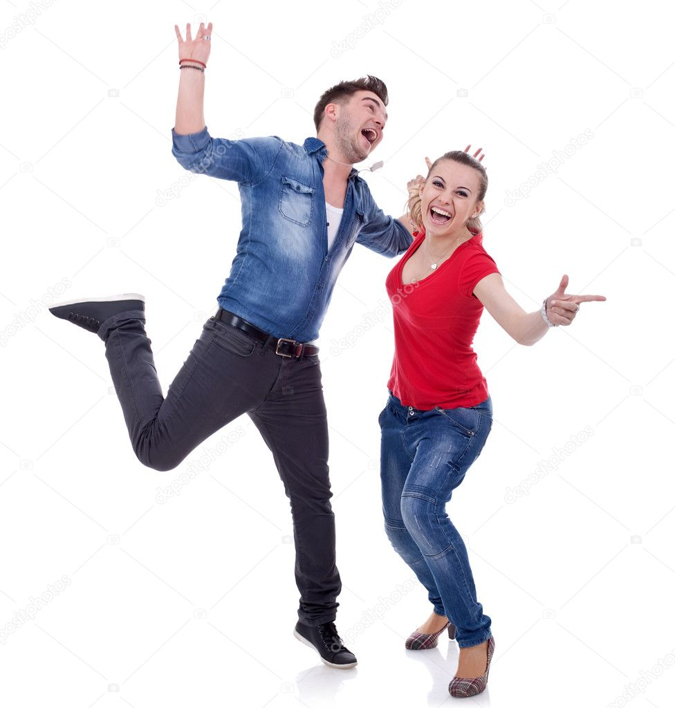 Portrait of an attractive young couple celebrating success with hands raised over white background   Stock Photo #5589809
