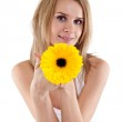 Pretty young woman holding a flower — Stock Photo