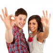Couple making ok gesture - Stock Photo