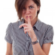 Business lady holding her finger near the mouth — Stock Photo