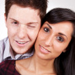 Young couple embracing and smiling — Stock Photo #5864386